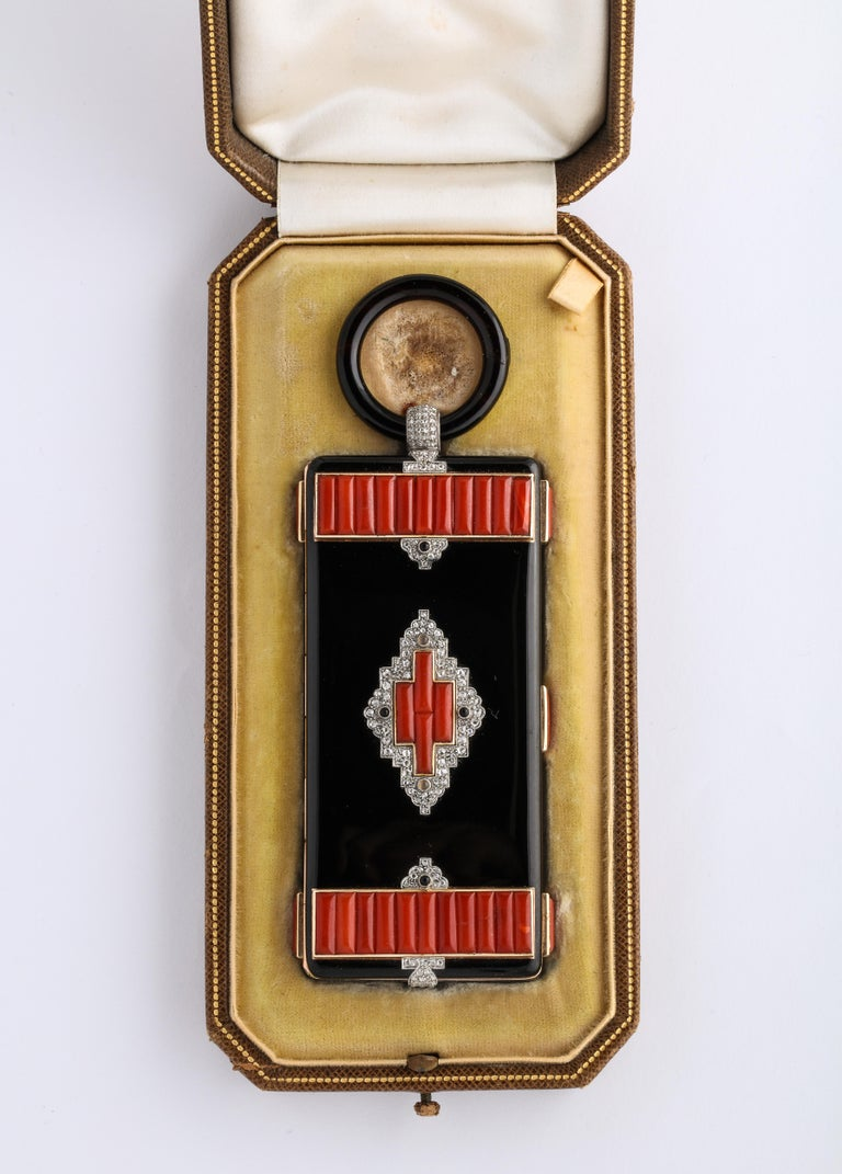 Rare 1930's Original Art Deco Cartier Vanity Case w/ original Fitted Box. Appears to have never been used, adorned with black enamel, Diamonds and beautifully carved coral, with an Onyx loop.  Very Attractive and presentable!  total weight 177