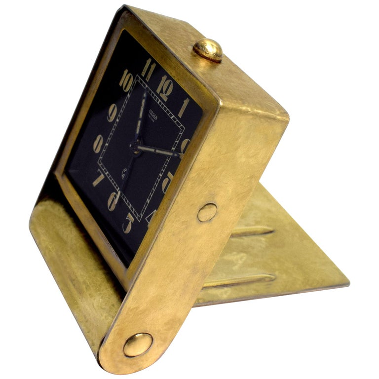 This is for a beautiful original and extremely stylish Art Deco desktop alarm clock made by Jaeger LeCoultre. It dates to the 1930s, it has a 30 hour movement and it has a gold toned scumbled effect metal casing with a back dial face and stylised