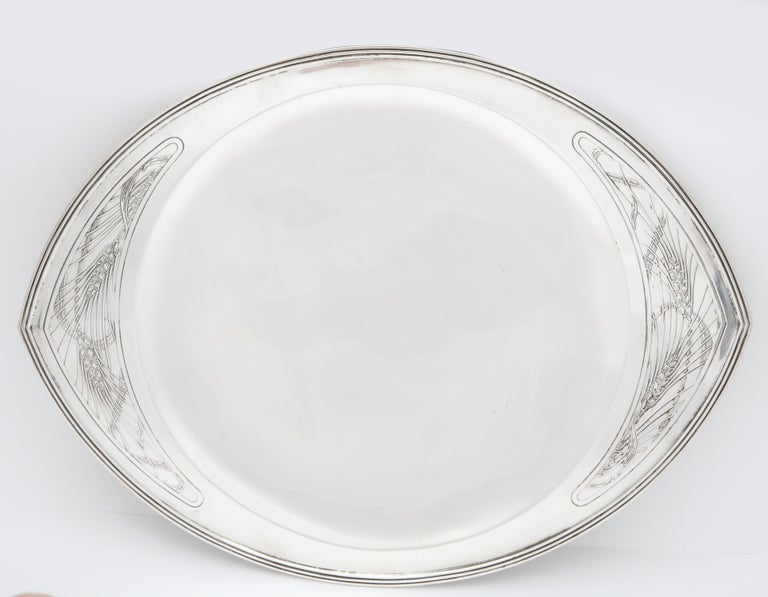 Rare, Art Deco, sterling silver tray on low pedestal base, Tiffany and Company, New York, year inventory hallmarked for 1914. Measures 13 1/2 inches wide x 10 1/2 inches deep x 1 inch high from bottom of base to tray itself. A wheat design adorns