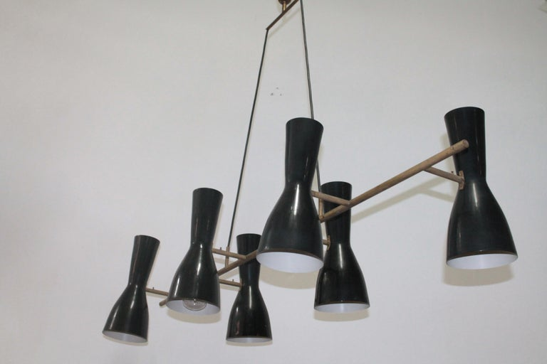 Rare and large suspension lamp 1950s, Stilnovo manufacture. The brass structure with six adjustable double-light enameled aluminum cups. It goes perfectly with a large dining room.