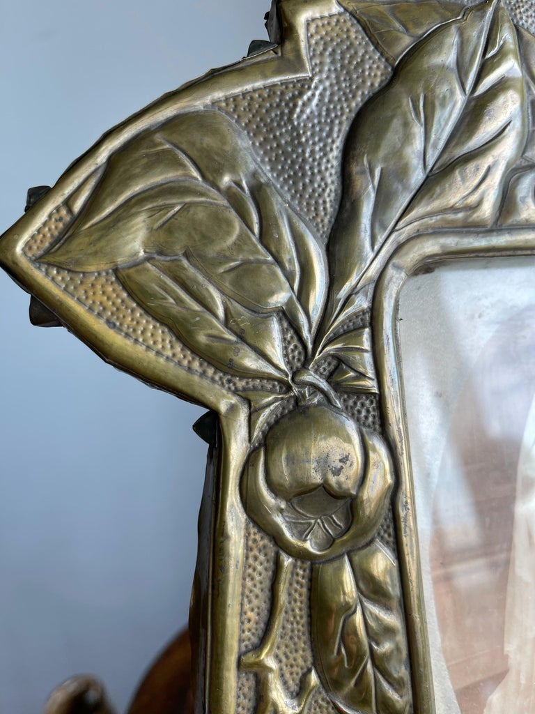 Exceptional brass on wood desk picture frame with a rare and marvelous decor.   If you are a collector of rare and great looking Arts & Crafts antiques in general and if the rose hip (aka rose haw) holds a special place in your heart as well then