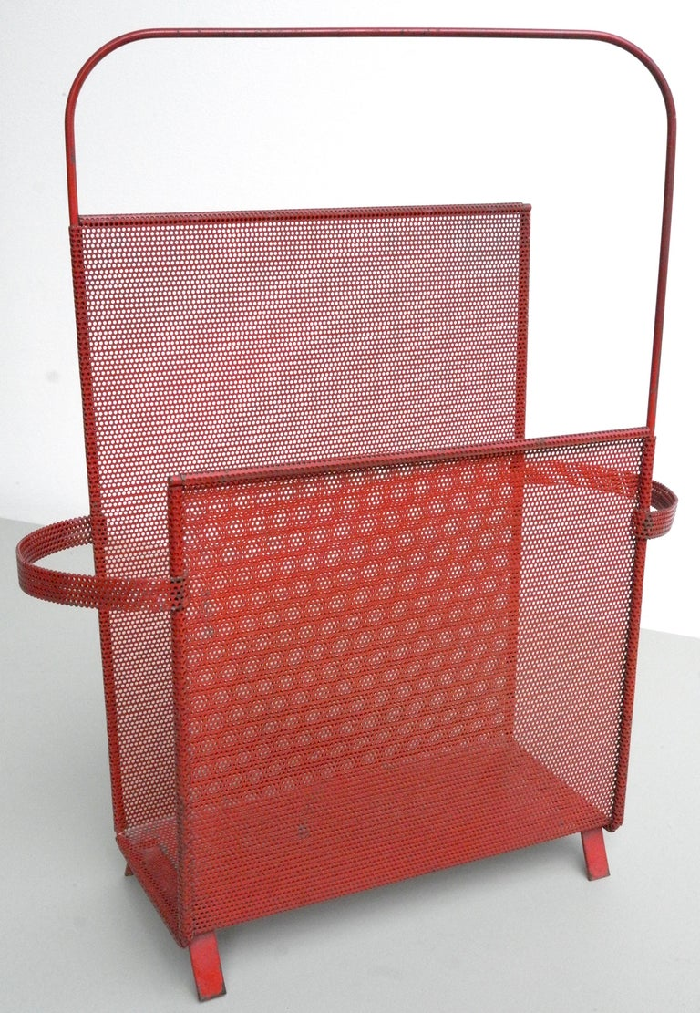 Magazine holder designed by Mathieu Matégot, rare Asymmetrical model in red metal. Manufactured by Ateliers Matégot, circa 1950. Folded, perforated metal.