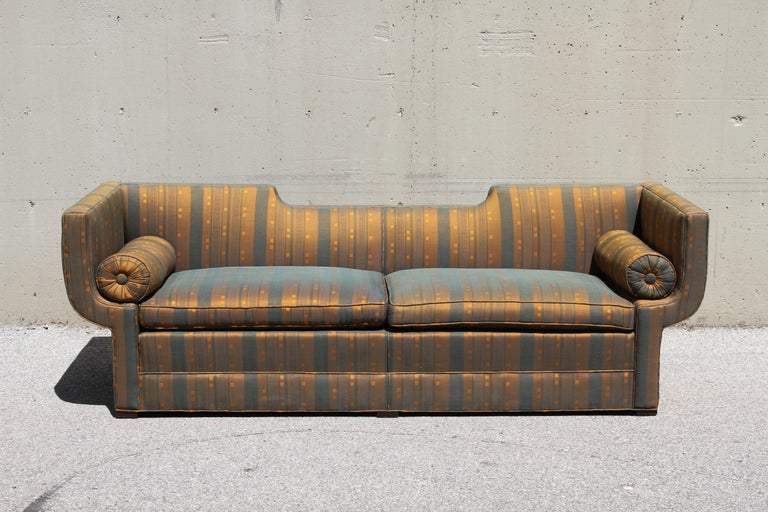 Rare Baker Furniture Co. sculptural Gondola sofa with original striped silk fabric, circa 1960. This elegant sofa is from a one owner estate of an artist, that was filled with Baker, Harvey Probber, Kelvin & Laverne and other midcentury furniture.