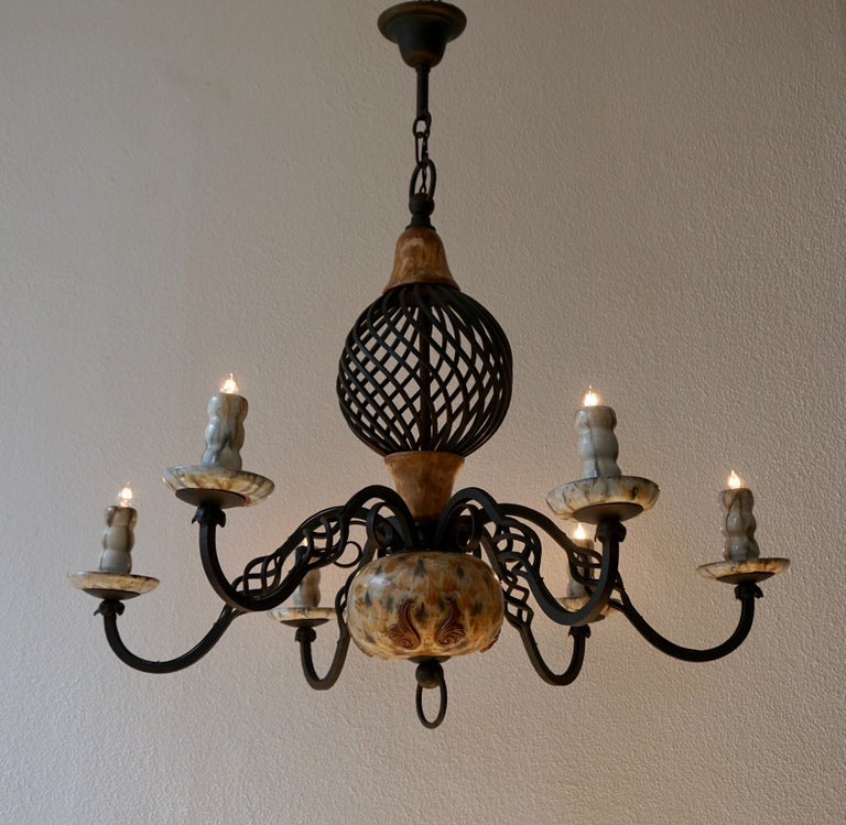 Rare ceramic and wrought iron chandelier by Antoine Dubois,Belgium.