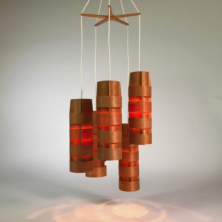 Beautiful and extremely rare piece of Swedish lighting design by renowned designer Hans-Agne Jakobsson for Markaryd, 1960s.  The all original cluster chandelier has five tube shaped that each consists of eight bent pinewood lames.   The original