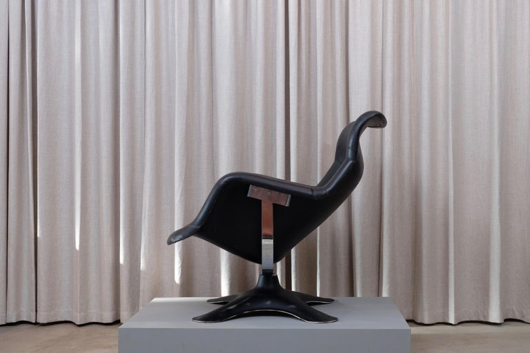 Very sought after Karuselli lounge chair seldom in black designed in 1965 by Yrjö Kukkapuro, made by Haimi, Finland has a fiberglass seat shell and base. Exclusive manufactured leather upholstery, chrome and fiberglass in very good condition.