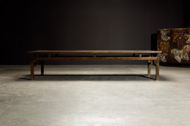 A rare example of the 'Classical' acid etched bronze cocktail table by Philip and Kelvin LaVerne utilizing the base style of the large rectangular 'Chin Ying' design, signed on the table top with the LaVernes signature.   The large 70