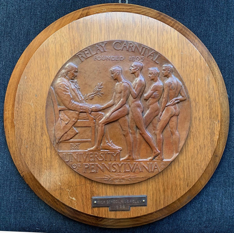 Large and rare, this bronze bas relief plaque was created by the world's leading sculptor of young athletes for the University of Pennsylvania's Relay Carnival, now known as the Penn Relays, a prestigious track and field event for college athletes