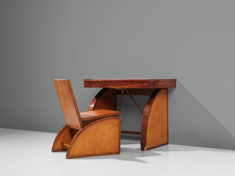 Brown Saltman, desk with chair, wood, United States, circa 1940s  A cubist desk with chair. This set holds a similar idiom with clear forms and lines. Both the chair and the desk are resting on triangular legs. These triangles have two angular,