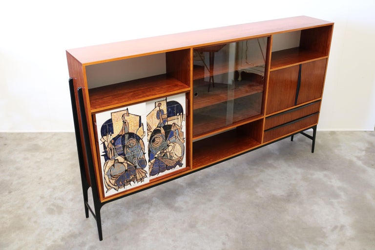 A magnificent piece of design history, this vintage cabinet / highboard is designed by the famous Belgium designer: Alfred Hendrickx for Belform. However this is a special one of a kind edition for the ''1958 World Expo in Bruxelles''. For the world