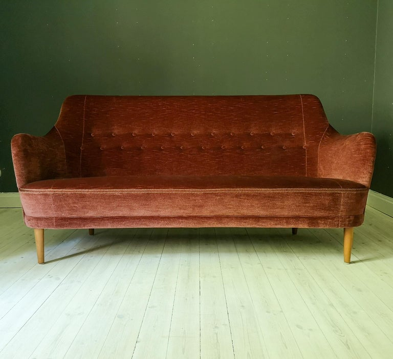 This midcentury icon sofa was designed by Carl Malmsten and this one was produced by O.H Sjögren. The sofa has a rare fabric in shifting red/pink velvet. It's in very good vintage condition.   Measures: W 180, D 68, H 86, seat height 40 cm.
