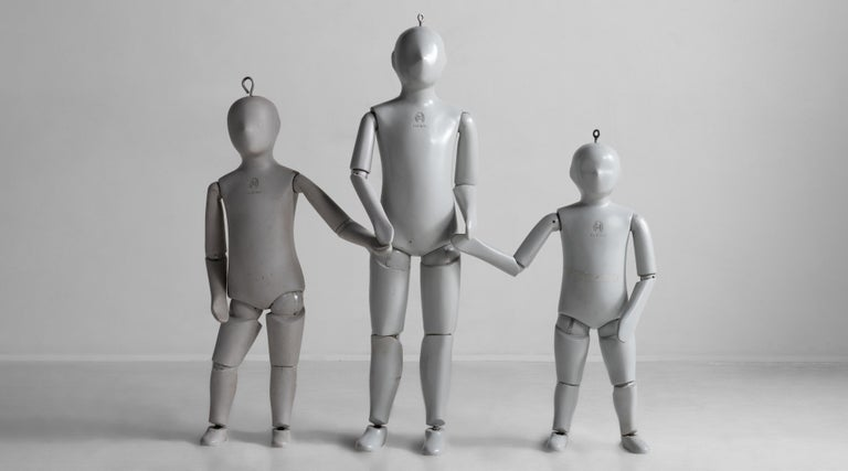 Rare cast aluminum crash test dummies  life-size dummies with articulating joints, original grey paint and stamped with numbers on top of heads.  Measures: 32