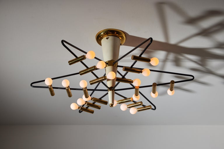 Rare ceiling light by Giampiero Aloi for Stilnovo. Designed and manufactured in Italy, circa 1950s. Enameled metal, brass. Wired for U.S. standards. Original brass canopy. We recommend eighteen E12 candelabra bulbs 25w maximum per bulb. Bulbs not