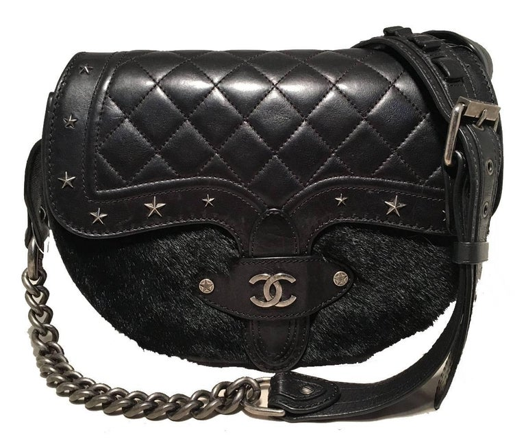 fabulous RARE Chanel Vintage Dallas Studded Saddle Bag in excellent condition.  Black leather exterior trimmed with soft black mink fur and antiqued silver hardware.  Buckled chain and leather shoulder strap can be adjusted and worn cross body