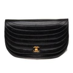 Rare Chanel handbag in waved black lambskin and gold hardware