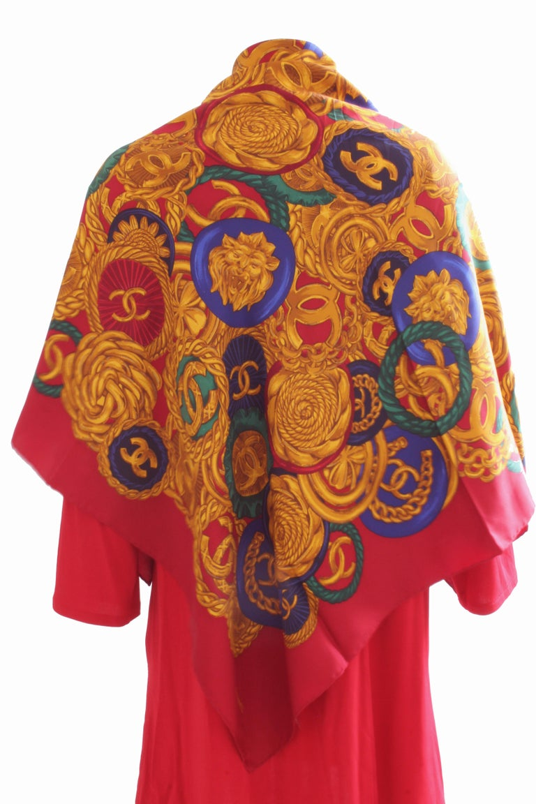 This fabulous scarf was made by Chanel, most likely in the late 90s.  Made from a silk twill fabric, it features a bold and colorful CC logo coin motif throughout.  It measures an incredible 40in square, making it perfect for wearing as a scarf or