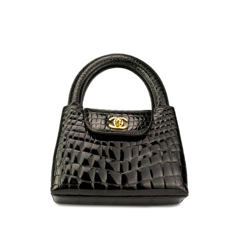 """Rare Chanel Vintage 90's Crocodile Alligator Top Handle Micro Mini Kelly Tote   1997 {VINTAGE 23 Years} Gold Hardware Interior zipper pocket  Black Lambskin interior lining 8.5"""" H x 7"""" W x 2.5"""" D Handle 2.8"""" Made in Italy   House of Carver News:"""