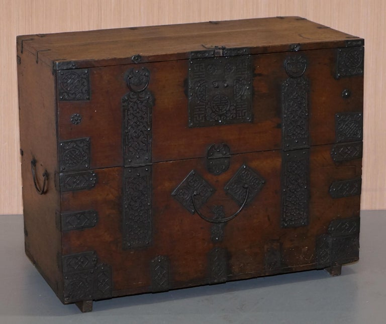 We are delighted to offer for sale this very rare circa 1840 Chinese hand carved campaign chest with ornate metal strap work depicting the Swastika  A very good looking well made and decorative piece, this is the oldest of its type that I have