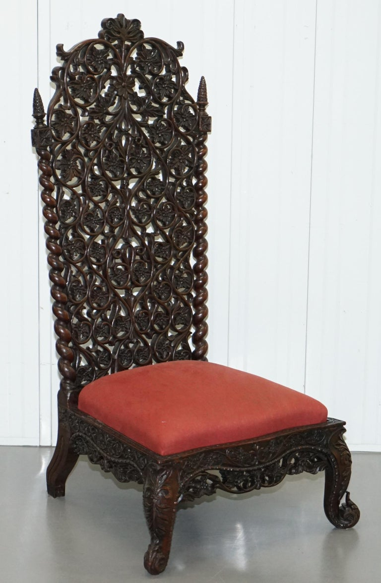 We are delighted to this absolutely stunning solid Rosewood hand carved high back low seat Burmese chair