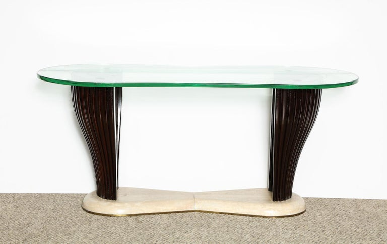 Curved and ribbed wood base with parchment-covered foot. Irregular glass top with etched surface.