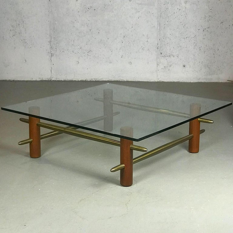 Excellent and rare early 1950s coffee table made of walnut, glass and solid brass stretchers, by T.H. Robsjohn-Gibbings for Widdicomb Furniture Co, circa 1952. The size and craftsmanship are hard to capture in the pictures. When taking it apart to