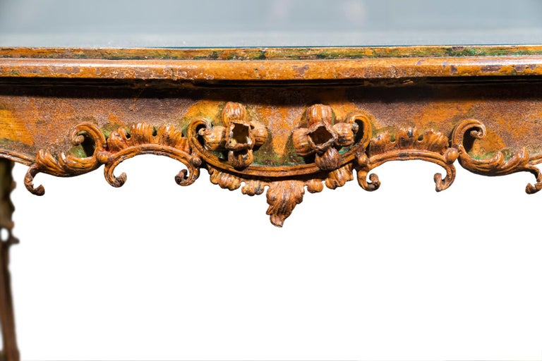 Rare coffee table, Iron and sheet metal decorated with palmets, flowers, in the style of the Regency, Original beveled tabletop, Traces of yellow daffodils lacquer, France, circa 1900.  Measures: Width 71 cm, depth 45 cm, height 57 cm.