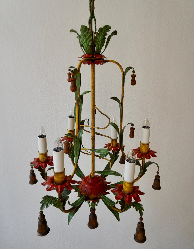 Beautiful iron painted chandelier with wooden bells. Dimension: Diameter 48 cm. Height fixture 65 cm. Total height with chain 110 cm. Six E14 bulbs.