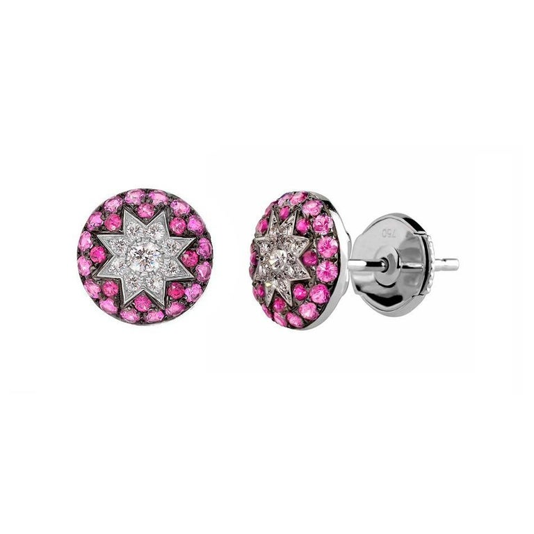 Ring White Gold 14 K (Matching Necklace and Earrings Available)  Diamond 1-RND-0,03-G/VS2A  Diamond 8-RND-0,7-G/VS2A  Ruby 8-0,09ct Pink Sapphire 19-0,23ct  Weight 2.41 grams Size 16  With a heritage of ancient fine Swiss jewelry traditions, NATKINA