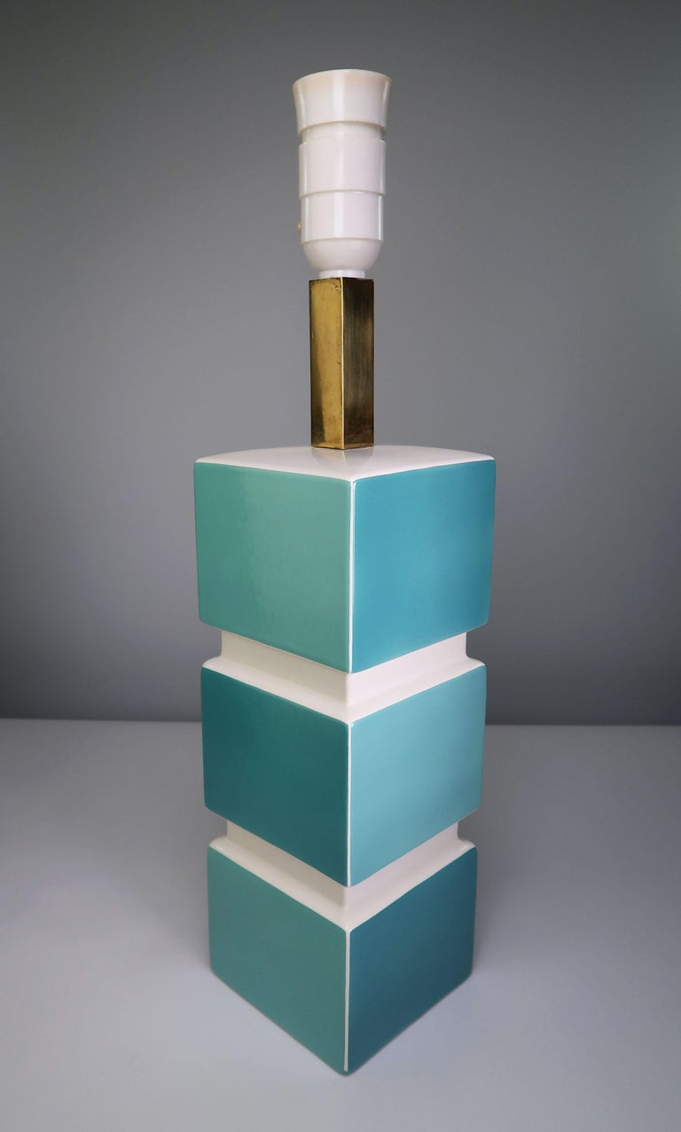 Extremely rare, sculptural and geometric Italian inspired Danish modernist porcelain table lamp by Søholm Stentøj. Glazed squares with nuances of turquoise aqua blue interchanging on the four sides of the rectangular lamp base with chalk white top,