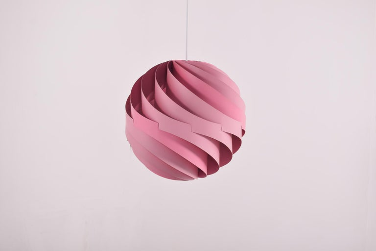 Weisdorf is known for some of the most beautiful Danish lighting designers and the Turbo is no exception. The original turbo ceiling light was made in white, orange and this pink lacquered version in 1967 by Louis Weisdorf for Lyfa, Denmark. The