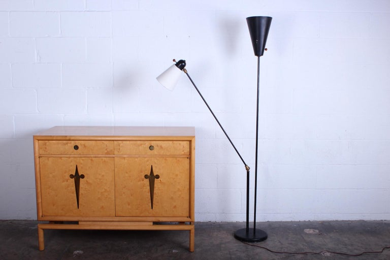 A rare floor lamp with articulating arm. Designed by David Wurster for Raymor, 1952.