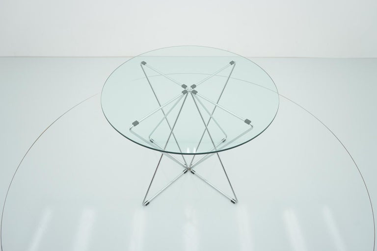 Rare glass and chromed steel dining table by Till Behrens, Schlubach Germany 1983. The base is signed. Very good condition.