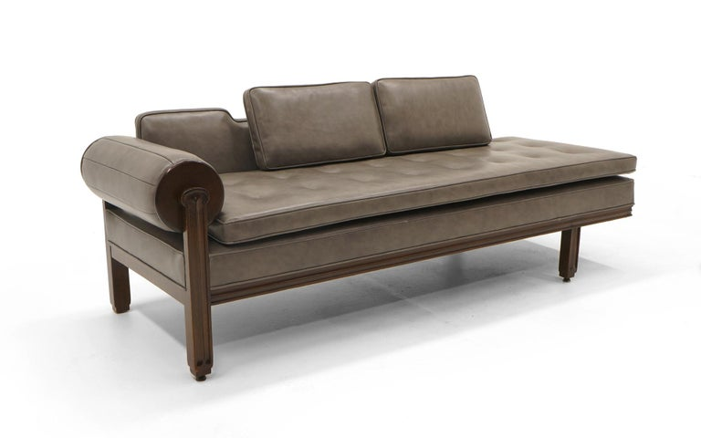 Rare Edward Wormley for Dunbar sofa chaise. One arm with a rolled cushion that is attached via a mechanism that the cushion spins. Expertly reupholstered in grey Spinneybeck leather.