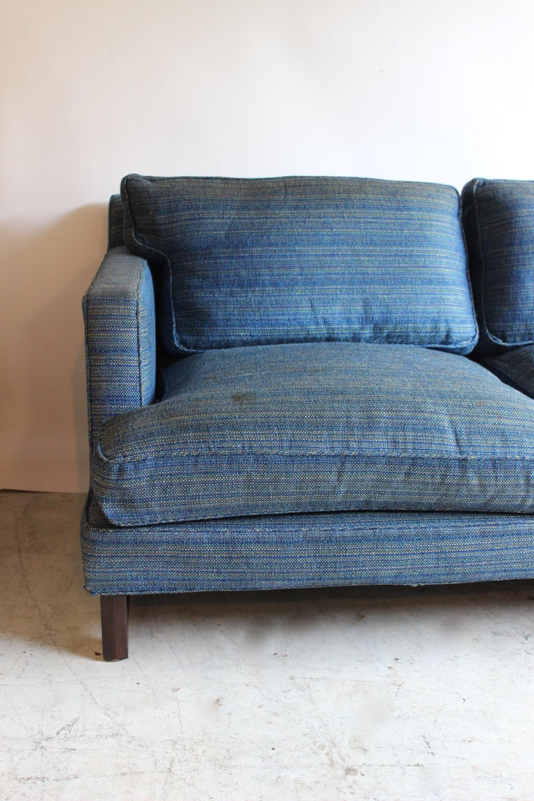 Rare sofa by Edward Wormley. Walnut legs with stretchers and original upholstery. Some staining to fabric.