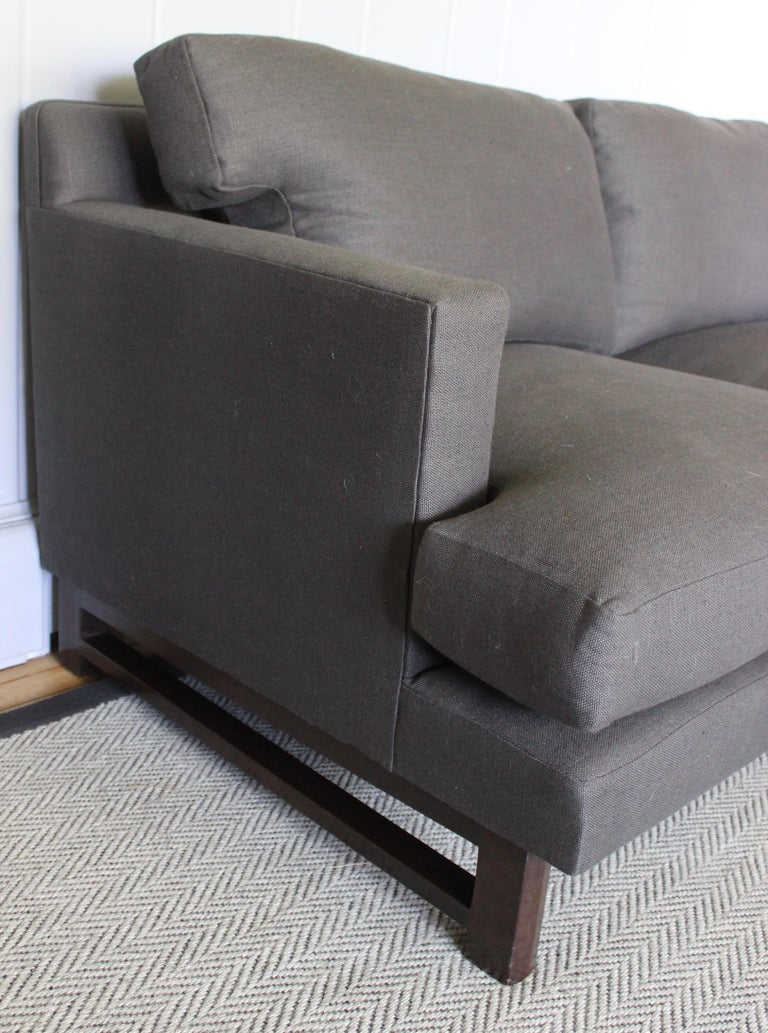 Rare sofa by Edward Wormley. Walnut legs with stretchers. Newly upholstered in Belgian linen.