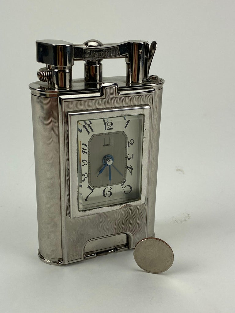 A very rare piece from Dunhill, limited to 200 pieces, this lighter/clock combination was made to honor some of Alfred Dunhill's original designs from the early 20th century. The scale and weight are truly incredible. Housed in it's original box. A