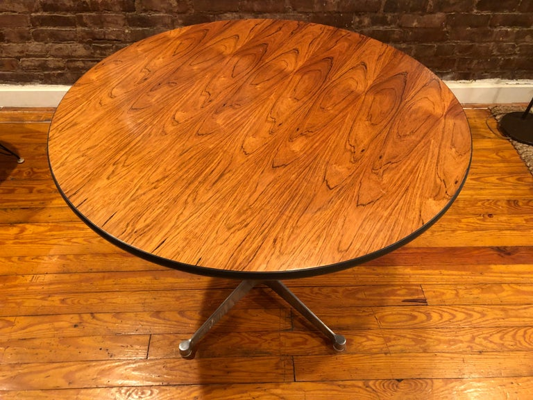 Gorgeous and supremely rare Herman Miller 36 inch dining table in Brazilian rosewood (this wood was discontinued in 1993 due to environmental regulations). The grains are absolutely spectacular and highly figured. The polished aluminum contract base