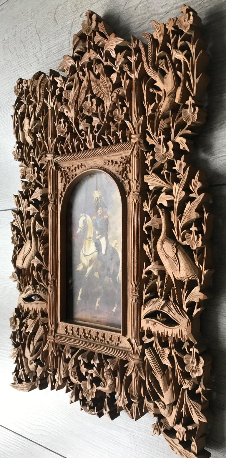 This rare and probably colonial picture / photograph wall frame comes with incredibly elaborate artwork.  This stylish and meaningful picture frame will make great decoration on your wall and with an image of a loved one inside, it will become even