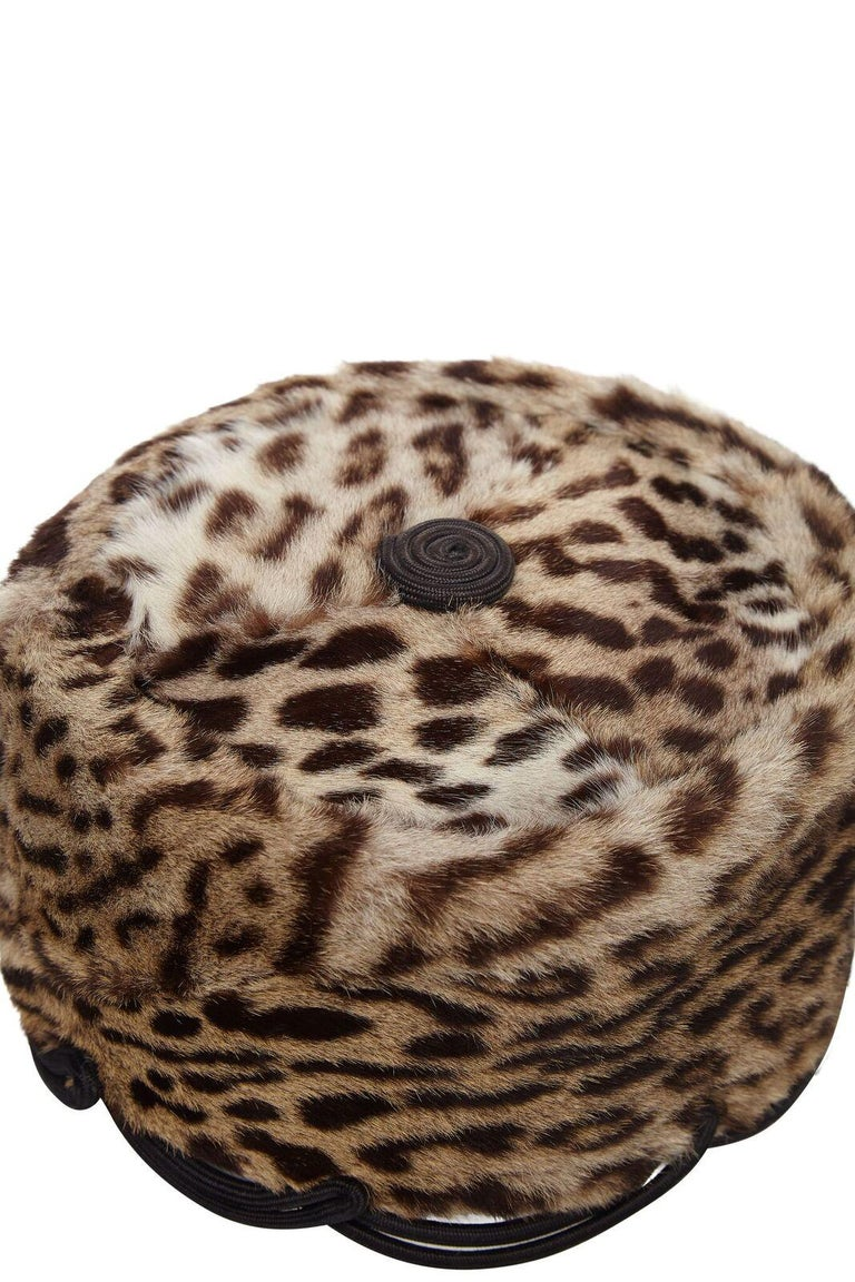 This glamorous early 1940s ocelot fur pillbox hat is incredibly rare, in superb vintage condition and previously owned by American socialite Jolie Gabour, mother of Za Za by repute. The soft fur is lined in silk satin and trimmed with a stiff boned