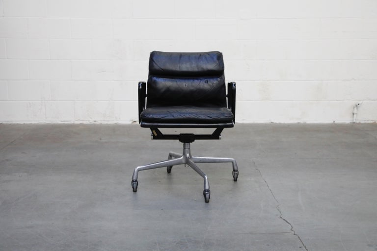 A rare early production year signed and dated collectors example of a rare colorway, black leather on black frame with aluminum base 'Soft Pad' Management Chair, dated February 3, 1976 - the same great year that brought us 'Rocky', 'King Kong', and