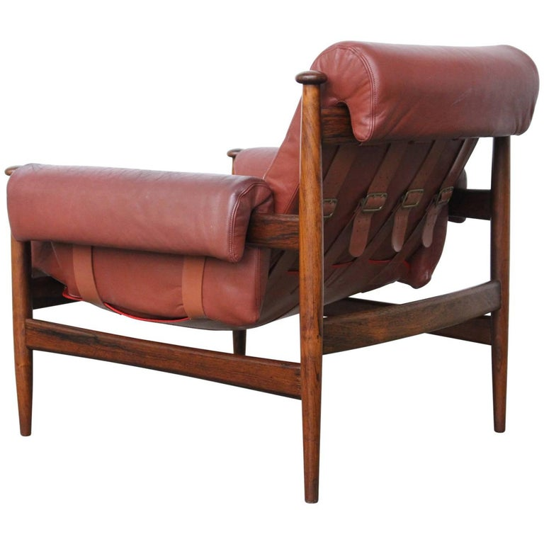 Beautifully sculpted lounge armchairmodel Amiral by Erik Merthen for Ire Møbler, Sweden, 1964. Made of solid rosewood and thick Bordeaux-red leather cushions, all in excellent condition. The tension of the backrest is variable by means of buckled