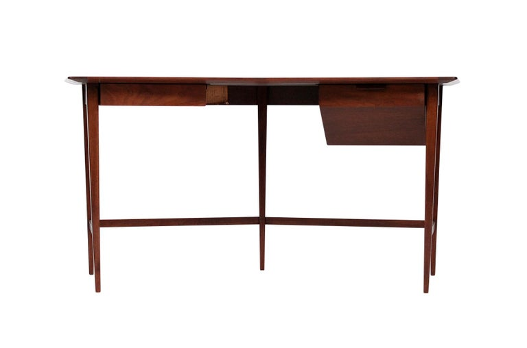 Rarely seen and delicately designed Edward Wormley for Dunbar desk in walnut.
