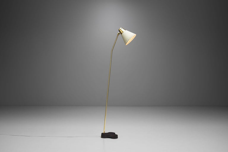 This one-of-a-kind floor lamp is a delightfully distinctive model, with immediately recognizable details. According to the Museum of Malmö, Einar Bäckström founded his workshop in 1918 for the manufacture of lighting and ornaments, and as the museum
