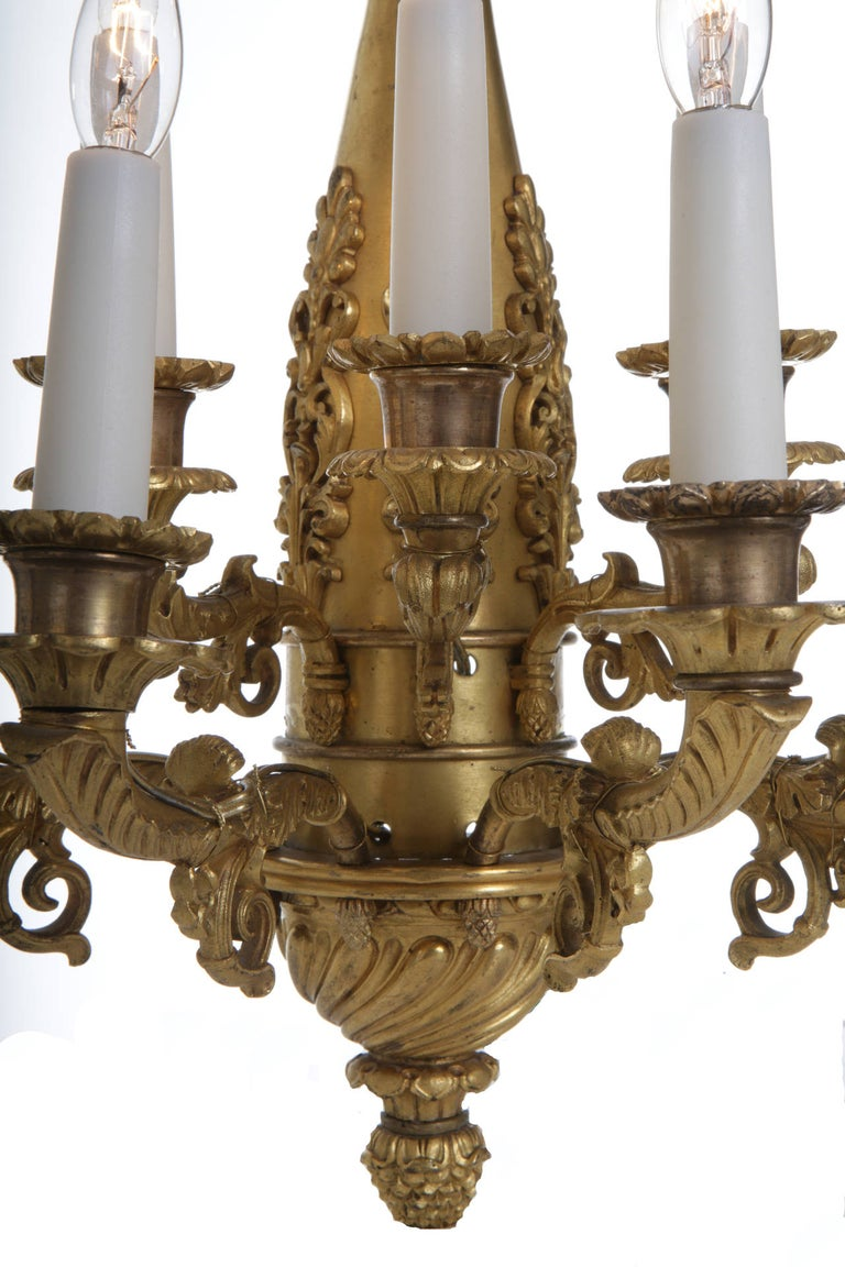 A rare pair of Charles X ormolu bronze seven branch wall lights in the Empire Revival style. Exclusive mercury gilding and lately electrified.