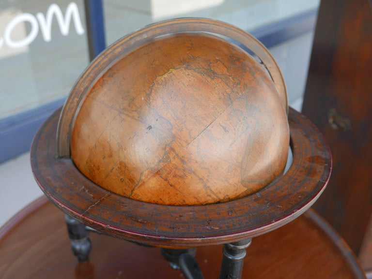 The new 12 inch British terrestrial globe representing the accurate positions of the principal known places of the earth from the discoveries of Captain Cook and subsequent circumnavigators to the present period 1802 with Additions to 1807 with