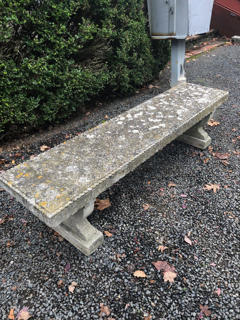 This rare-form bench is hand-carved and has been certified by a geologist as Portland Stone, the primary stone used in England for building facades during the 18th and 19th centuries. It features a stunning roped-edge decoration to the top, as well