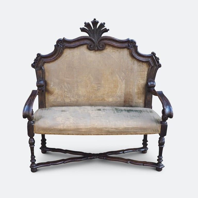 An extremely rare English oak-framed upholstered sofa, late 17th century, possibly early 18th Century. Very few examples remain of this early type of English Sofa.