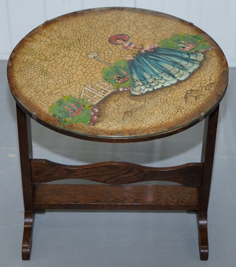We are delighted to offer for sale this lovely little handmade in England tilt top oak side table with glass cased hand painted picture
