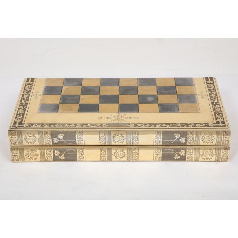 Rare English silver-gilt book-form chess and backgammon game board, circa 1976.    This exceptional and rare solid silver chess board converts into a backgammon board and can also be placed in a bookshelf to add more opulence. (3 in 1).    This was