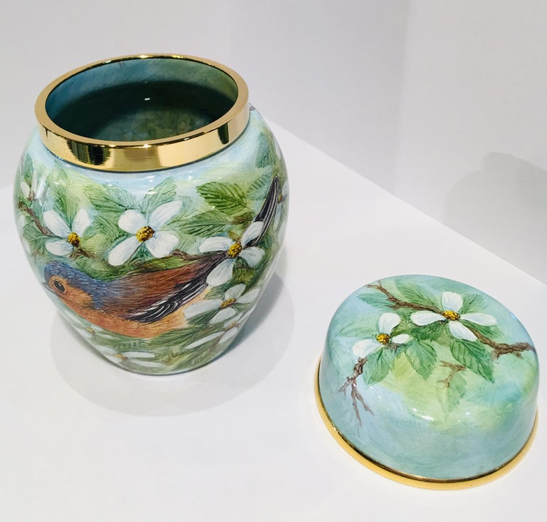 Finest quality handmade and hand painted enamel miniature ginger jar or lidded vase, in perfect condition, features a gilt metal rim and lid (also with gilt metal rim) made by Moocroft.  Limited edition of only 75 pieces made.  Outside of jar